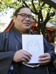 自ら描いた結婚相手の似顔絵を手に笑顔の錦木関=29日、福岡市東区の伊勢ノ海部屋宿舎
