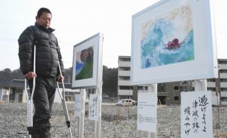 東日本大震災津波の教訓を発信する看板を立てた木村正明さん