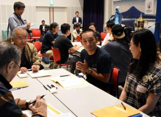 約3カ月後に迫る大会の成功に向け結束を図る参加者=21日、釜石市・TETTO