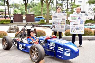 運転席に座るリーダーの千葉魁志さん。3年ぶりの優勝を目指す