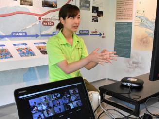 画面越しに花王グループの社員らとやりとりする菊池のどかさん。震災時の避難行動や教訓を伝えた